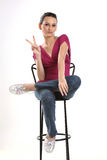 Young casual woman showing victory sign Stock Photography