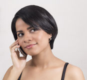 Young casual woman smiling on the phone Stock Image