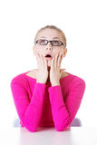 Young casual woman student expresses shock, surprise. Stock Photos