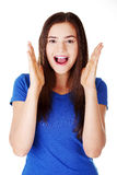 Young casual woman student expresses shock, surprise. Royalty Free Stock Photography