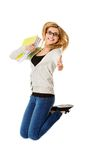Young casual woman, student jumping. Royalty Free Stock Photography