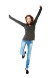Young casual woman, student jumping. Royalty Free Stock Image