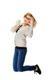 Young casual woman, student jumping. Stock Photos