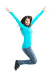 Young casual woman, student jumping. Royalty Free Stock Images