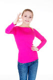 Young casual woman student showin OK gesture. Royalty Free Stock Image
