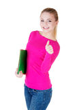Young casual woman student showin OK gesture. Royalty Free Stock Photo