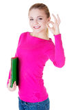 Young casual woman student showin OK gesture. Stock Photo