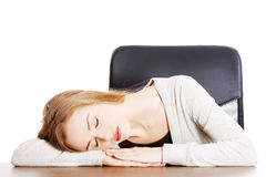 Young casual woman student is sleeping on a desk. Royalty Free Stock Photo