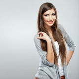 Young casual woman style isolated over white background. studio Stock Photos