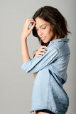 Young casual woman style over gray background. Studio portrait Royalty Free Stock Images