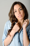 Young casual woman style over gray background. Studio portrait Royalty Free Stock Photo