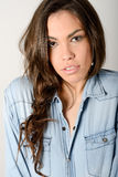 Young casual woman style over gray background. Studio portrait Stock Photo