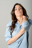 Young casual woman style over gray background. Studio portrait Stock Photography