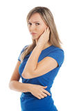 Young casual woman touching her ear. Royalty Free Stock Image