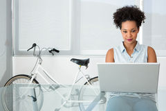 Young casual woman using laptop Stock Photography