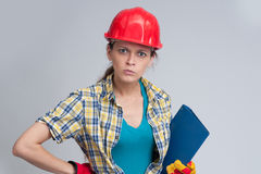 Young casual woman wearing safety helmet Royalty Free Stock Photos