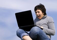 Young casual woman working on laptop Royalty Free Stock Images
