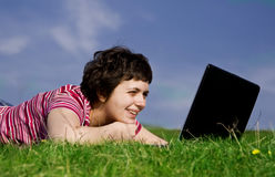 Young casual woman working on laptop Royalty Free Stock Image