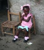 Young Catholic kindergarten school girl sits outside. Stock Photos