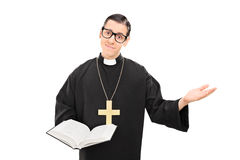 Young Catholic priest holding a bible Royalty Free Stock Photos