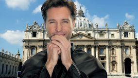 Young catholic priest in vatican city. Young catholic clergyman in saint peter's square, vatican city stock video