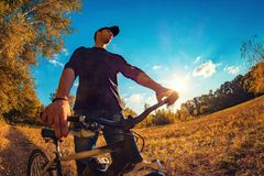 Young caucasian athletic guy on the sports bike staring into the Royalty Free Stock Image