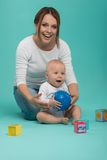 Young Caucasian attractive smiling mother playing Royalty Free Stock Images