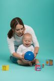 Young Caucasian attractive smiling mother playing Royalty Free Stock Image