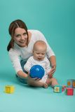 Young Caucasian attractive smiling mother playing Stock Photo