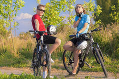 Young Caucasian Bikers Resting Outdoors Royalty Free Stock Photo