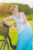 Young Caucasian Blond Laughing Outdoors Standing Near Her Bicycl Royalty Free Stock Images