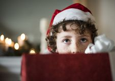 Young Caucasian boy with Christmas present box Stock Image