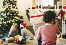 Young Caucasian boy with Christmas present boxes Royalty Free Stock Photos
