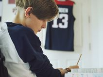 Young caucasian boy doing homework Royalty Free Stock Photo