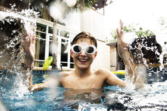 Young caucasian boy enjoying the pool Stock Photography