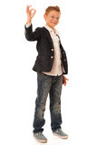 Young caucasian boy gesturing ok sign  isolated over white backg Stock Photos