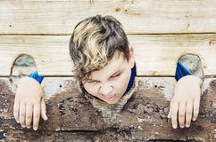 Young caucasian boy in medieval pillory Stock Images