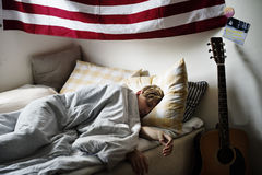 Young caucasian boy sleeping in bed Royalty Free Stock Photography