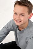 Young caucasian boy smiling. Close up of handsome young caucasian boy in studio Royalty Free Stock Image