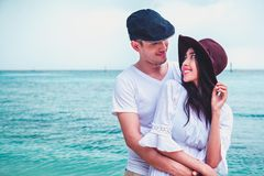 Young Caucasian boyfriend playing and having fun in sunny tropical destination for travel holiday. Happy couple in love on beach summer vacations,young stock photo