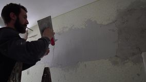 Worker spackle compound stock video footage