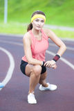 Young Caucasian Brunette Female in Athletic Sportgear Having Legs Stretching  Excercises Outdoors. Stock Photos