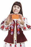 Young Caucasian Brunette Female Holding and Demonstrating Blank Card Royalty Free Stock Images