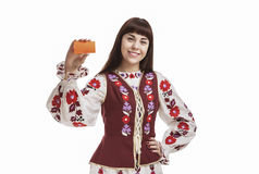 Young Caucasian Brunette Female Holding and Demonstrating Blank card Stock Image