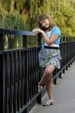 Young caucasian brunette girl on bridge Stock Photos
