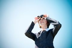 Young caucasian business lady with binoculars Stock Images
