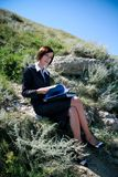 Young caucasian business lady with folders Stock Images