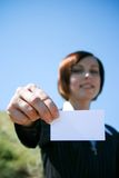 Young caucasian business lady with sheet of paper Royalty Free Stock Photography