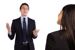 Young Caucasian business man smiling happily to a business woman Royalty Free Stock Photography