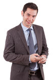 Young caucasian business man using a mobile phone. Portrait of a young caucasian business man using a mobile phone,isolated on white background Stock Photo